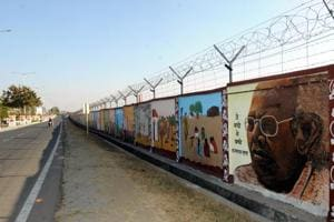 """Boundary wall of the Birsa Munda airport painted with tribal art forms for the Global Investors summit """"Momentum Jharkhand"""" in Ranchi"""