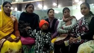 A group of women discuss at Sunflower Beauty Parlour in Rae Bareli discuss why their safety and employment are election issues.
