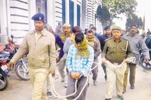 NIA sleuths presenting a terror suspect before a court in Patna.