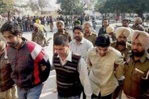Police produce Gurpreet Singh Sekhon (left) and others at the district courts in Patiala on Monday..
