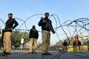 Police cordon off the site of a suicide bombing in Lahore. At least 16 people were killed when a suicide blast ripped through a protest in Lahore.