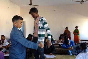 Bihar School Examination Board chairman Anand Kishor frisking a student at an examination centre in Patna.