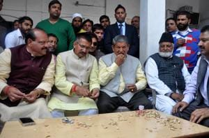 Back to work, confident Rawat clears files, meets officials