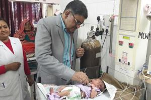 A doctor examining a newborn in a government hospital in Rajasthan.