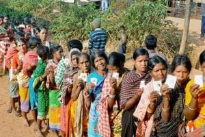 Voters wait in queue to exercise their franchise in the first phase of the Odisha Panchayat Polls in Kandhamal