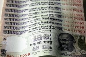 The seized new fake 100 rupees notes.