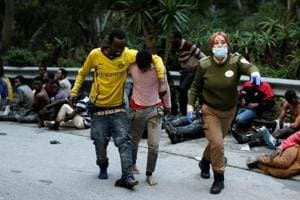 Hundreds of African migrants cross into Spain's Ceuta in second wave...