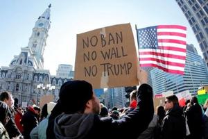 Trump's revised travel ban targets same countries but exempts green...