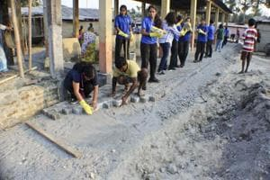 Assam school students donate money, labour to build road and toilets
