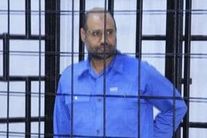 Saif al-Islam Gaddafi, son of late Libyan leader Muammar Gaddafi, attends a hearing behind bars in a courtroom in Zintan, June 22, 2014 .