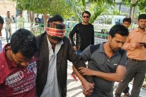Delhi resident Abdul Jabbar being produced before a special court in Bhopal on Sunday.