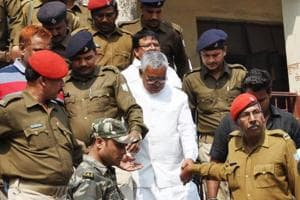 Police taking Ramadheer Singh ,Central President of Janata Mazdoor Sangh and uncle of Jharia MLA Sanjeev Singh, to jail . He was sentenced to life imprisonment by Dhanbad court three years ago  and was hence absconding.
