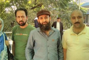 Tariq Ahmad Dar (wearing a cap) with his family members after he was released from Tihar.