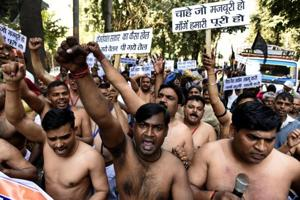 Delhi: MCD workers take off shirts to protest, demand uniforms