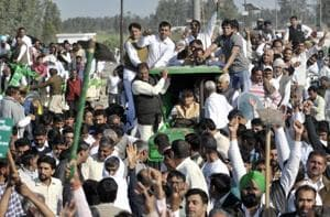 INLD leader Abhay Choutala along with other party leaders and workers protesting at Ambala in Haryana on Thursday.