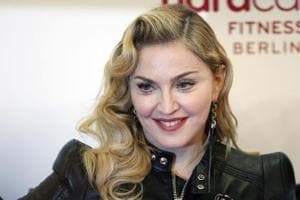 Madonna's newly-adopted twin daughters are bonding with their new...