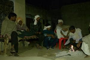 Villagers in Alwar's Sili Baodi take turn in guarding against a 'killer' leopard.  In this picture, men sit  near a fire at Chhotelal Meena's house. A leopard is suspected to have killed Meena's father on Feb 12.