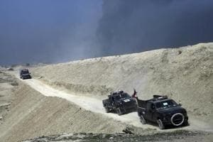 After eastern Mosul, Iraqi forces pushes into the western districts of...