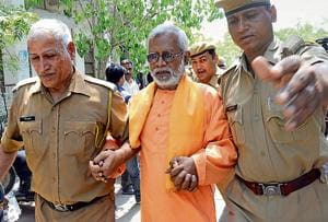 Aseemanand being produced at a special court.