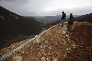 Flood from lake created by landslide closes major highway in Bosnia