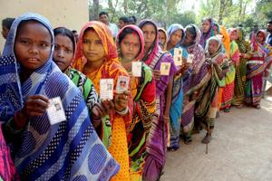 Voters stand in the queue during the last phase of Odisha