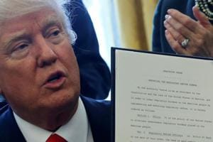 Donald Trump signs order aimed at removing 'job-killing' regulations