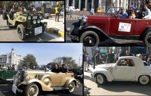 Around 100 vintage cars stood in the sun flashing their chrome and...