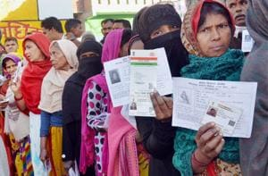 Women queue up at a polling booth in Amethi during the fifth phase of the assembly elections in Uttar Pradesh, February 27