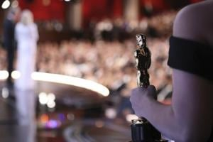 One of the best picture Oscar statuettes appears off stage as Warren Beatty and Faye Dunaway announce the best picture winner at the Oscars on Monday.