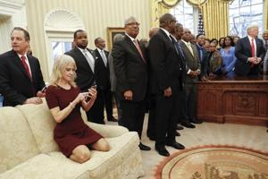 'Alternative etiquette': Trump's aide kneels with shoes on Oval Office...