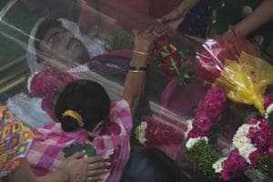Parvatha Vardhini grieves by the body of her son Srinivas Kuchibhotla, a 32-year-old engineer who was killed in an apparently racially motivated shooting in a crowded Kansas bar, in Hyderabad  on February 28, 2017.