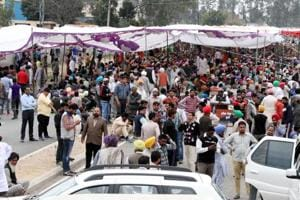 Followers of Dera Sacha Sauda protesting at Malerkotla road at Jagera village in Ludhiana on Tuesday.