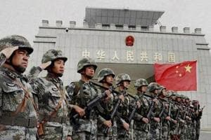 Chinese troops rumble through Xinjiang city in new display