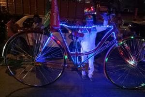 Sher Mohammed Khan showing his bicycle.