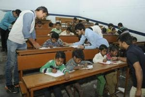 Budding techies of IET Lucknow light lamp of learning for slum kids
