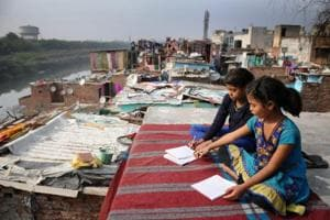 In pictures: A day in the life of slum dwellers