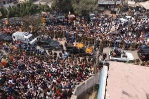 Crowds flood the streets of Varanasi as PM Modi arrives for roadshow