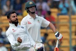 Virat Kohli  celebrates after the dismissal of Australian batsman Mitchell Marsh on Day 2 of the second Test match between India and Australia in Bangalore on Sunday.