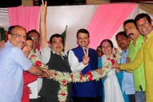 Union minister Nitin Gadkari, Maharashtra chief minister Devendra Fadnavis and BJP leaders celebrate after the municipal corporation poll results were announced.