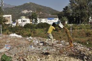 A man throwing garbage at Kalka's railway bridge in Panchkula.
