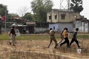 Police resort to lathi charge on villagers after violence during the public hearing organised by state government for social impact assessment on Adani Power Plant at Motia in Godda