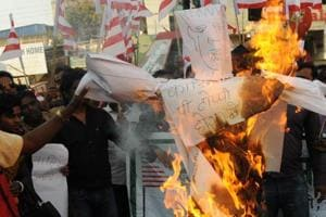 Protesters under the banner of Kendriya Sarna Samiti burning an effigy of Cardinal Telesphore P Toppo on Monday in protest against his recent meeting with state Governor Draupadi Murmu  on  Chotanagpur Tenancy (CNT) Act and the Santhal Pargana Tenancy (SPT) Act amendment issue.