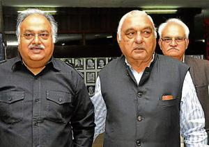 Former assembly speaker Kuldeep Sharma with ex-CM Bhupinder Singh Hooda in the assembly complex in Chandigarh.