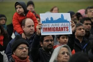 People listen during a vigil in honour of Srinivas Kuchibhotla, who was shot dead in Kansas, United States.  Hostility to economic migrants and outlandish Islamophobia are breeding an atmosphere of hate and violence.