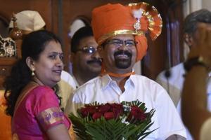 Ongoing Mayor Snehal Ambekar felicitates new mayor Vishwanath Mahadeshwar at BMC headquaters in Mumbai on Wednesday.