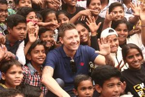 Former Australia captain Michael Clarke spent time with some underprivileged children at a city slum on Friday.