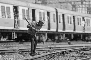 A track maintainer hammers the bolts on a fishplate along a track at the Chhatrapati Shivaji Terminus in Mumbai.
