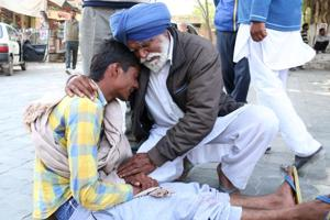 Victim children's grandfather Mukhtyar Singh consoles their uncle Jaspreet Singh in Bathinda on Tuesday.
