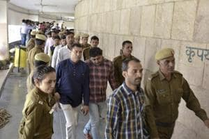 Police take the 2012 Maruti case convicts into custody at a district court in Gurgaon on Friday.