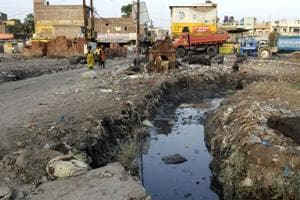 An open sewer littered with garbage near Velocity Cinema at Ring Road in Indore. Several project proponents not implementing basic conditions such as not discharging waste water without treatment were found.